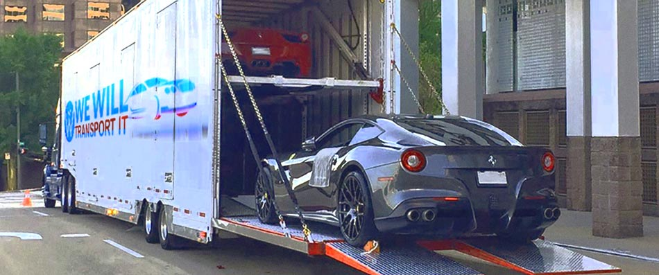 Hardside enclosed Carrier with a lift gate loading an Ferrari vehicle